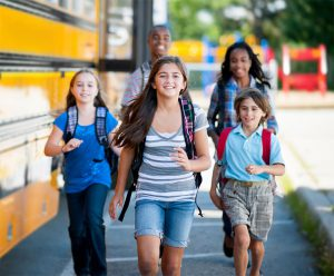 School safety makes kids smiling walking to school.